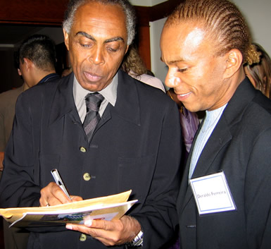 Gilberto Gil signs an autograph
